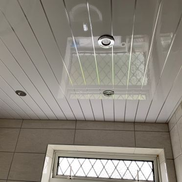 White And Silver Strip Ceiling Panel With SpotLights